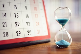 Calendar and Sand Timer to Show Long-Term Disability Deadlines