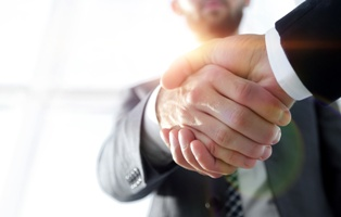 Long-Term Disability Client Shaking the Hand of a Lawyer