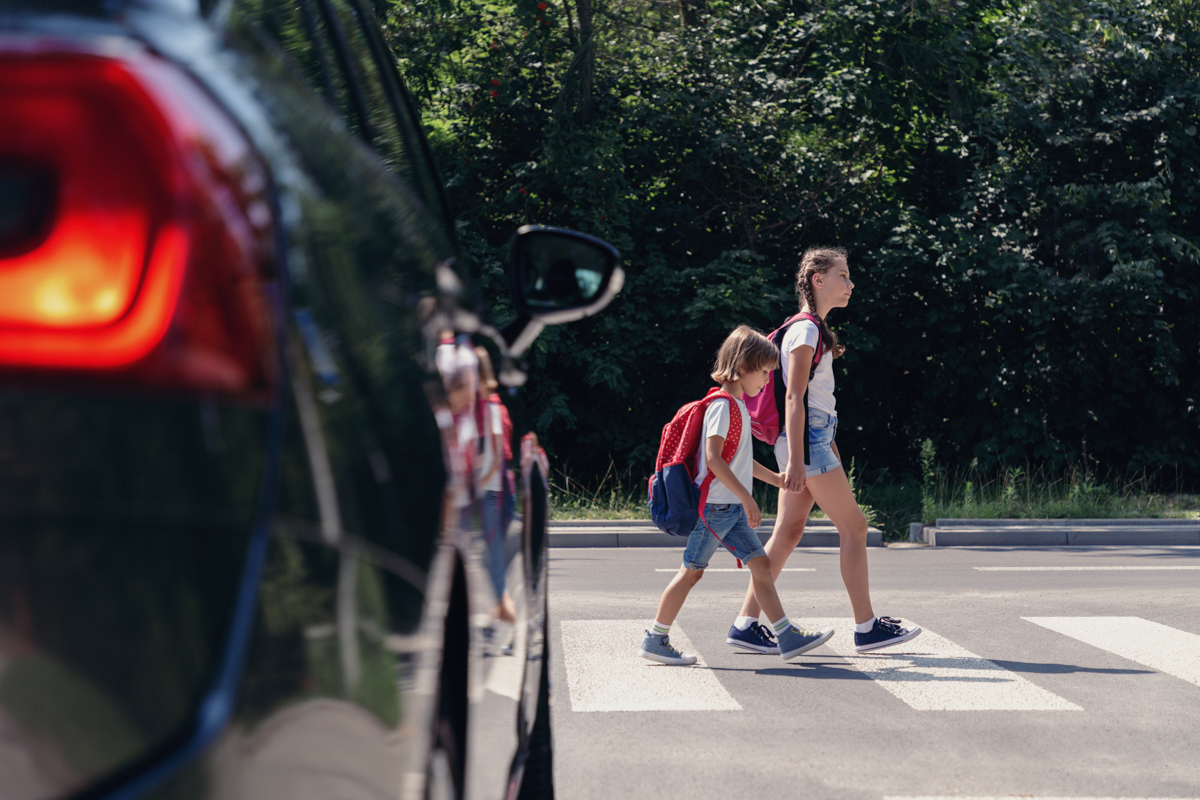 A school-aged child is in a pedestrian crossing with a car approaching quickly. When minors are injured in accidents in Massachusetts, they may get structured settlements