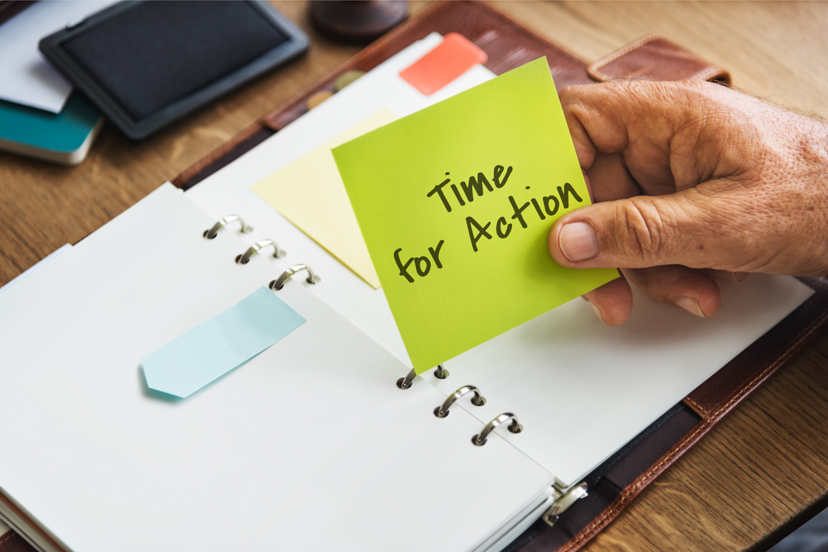 "A photo shows a planner and a woman holding a post it that says ""time for action."" If you've been injured in Massachusetts you typically have 3 years to hire an injury attorny"