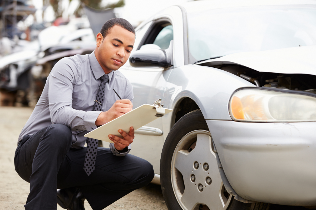 A Massachusetts Accident Reconstructionist is evaluating a car after a Boston Car Accident as part of an injury claim