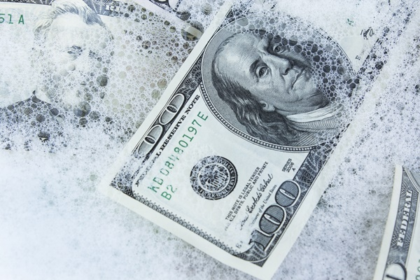 Money in soapy water to symbolize that the goal of the CTA is to prevent money laundering