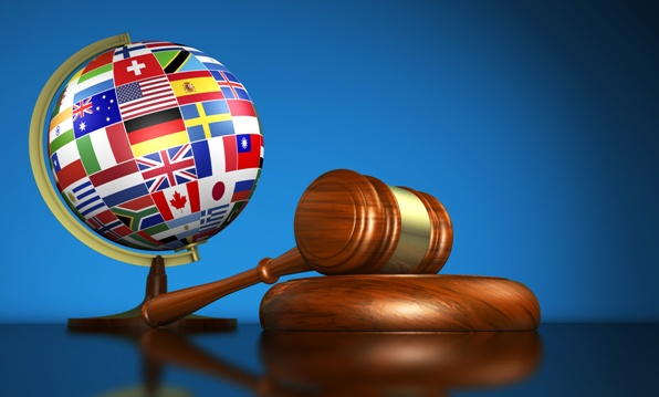 Flag-covered globe next to a judge's gavel