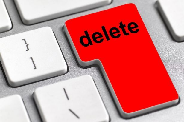 """A keyboard with a large red """"delete"""" key."""