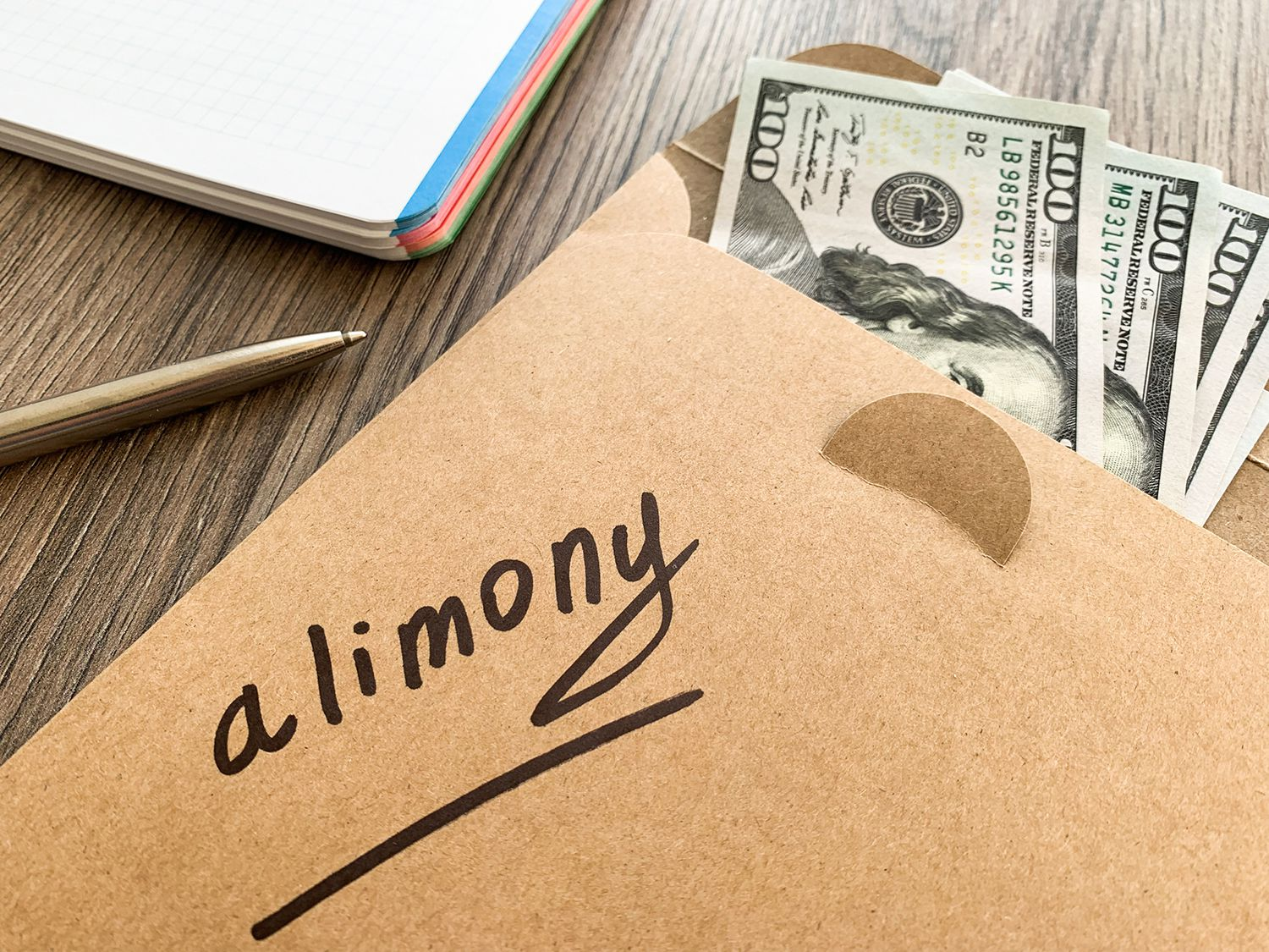 "Envelope with the word ""alimony"" written on it."