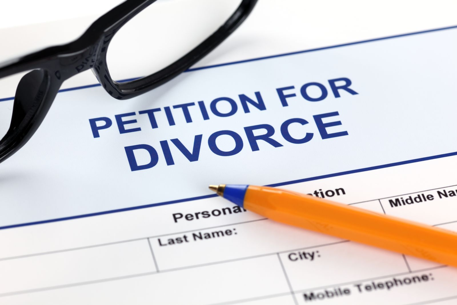 New Mexico Petition for Divorce form along with glasses and pen.