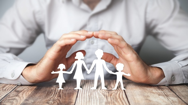 Hands of an international estate planning attorney protecting your family