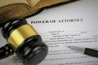 Power of Attorney Paperwork With a Wooden Gavel