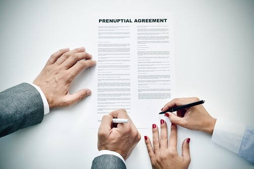 New Jersey Couple signing Prenuptial Agreement