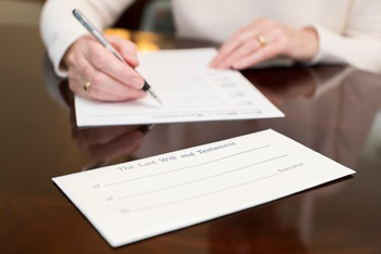 Woman writing a Will document