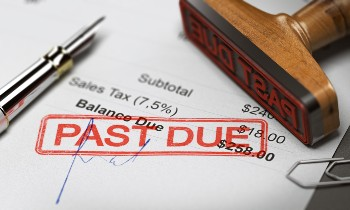 Debts must be settled before assets can be distributed.