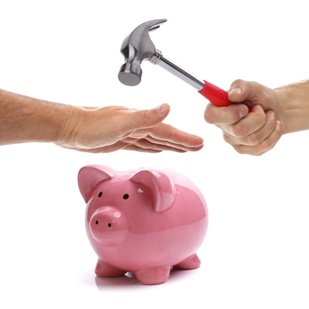 Man Protecting a Piggy Bank From a Hammer