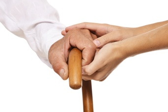 Incapacitated Adult Holding a Caregiver's Hand