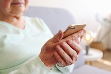 Elderly Woman Answering a Scam Phone Call