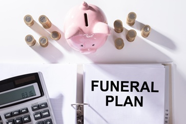 Funeral Plan Paper With a Piggy Bank and Money