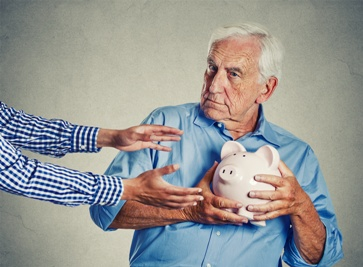 Man Protecting His Savings From Another Man