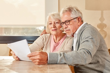 Older Couple Looking at Retirement Documents