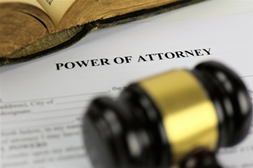 Power of Attorney Paperwork With a Gavel