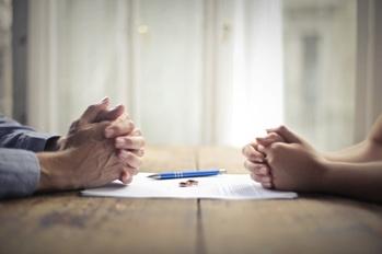 Married Couple Looking at Divorce Paperwork