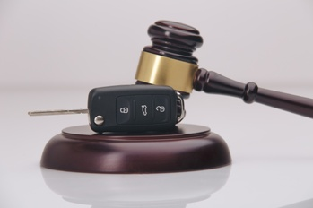 Car Key With a Judge's Gavel
