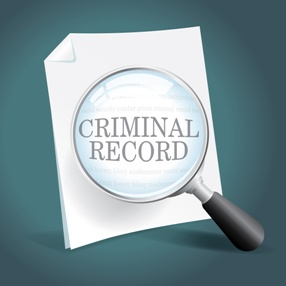 Criminal Record Paper Under a Magnifying Glass