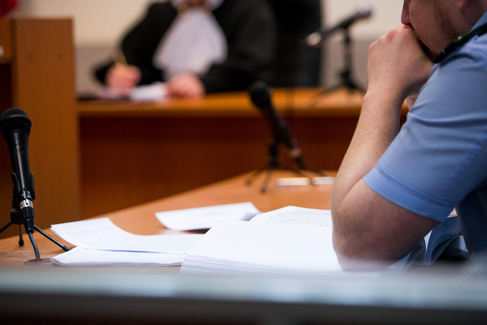 Defenses For Assault Charges, Defendant Sitting in Court