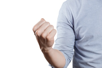 Man Holding His Fist Up in a Threatening Manner