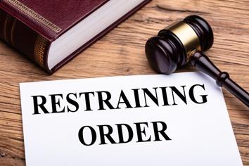 Restraining Order Paperwork With Gavel