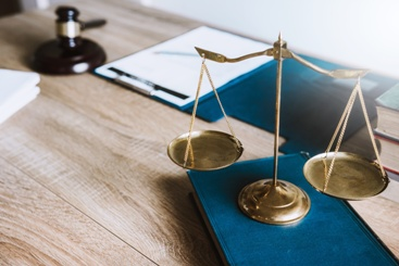 Scales of Justice and Law books on a Desk