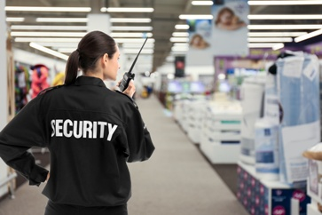 Security Guard in a Store Observing a Theft
