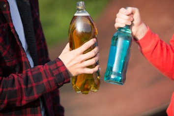 Teens With Bottles of Alcohol