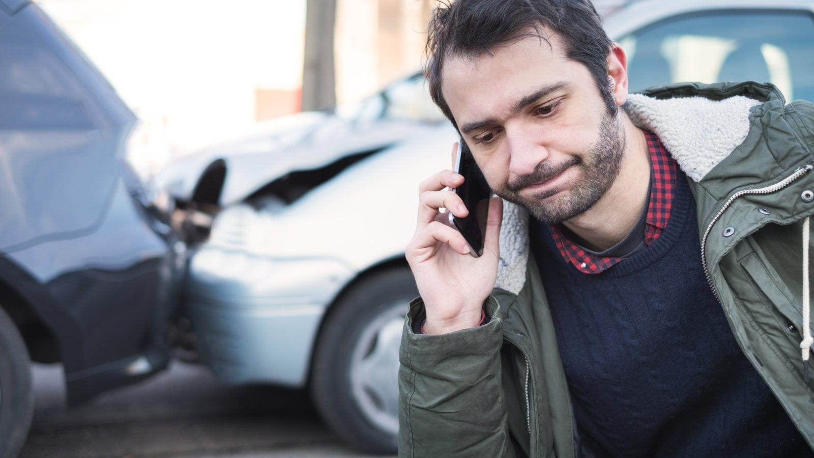 Man on Phone With Insurance Company After Getting in a Car Accident The Law Offices of Matthew Konecky, P.A.