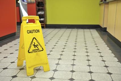 caution sign on restaurant floor