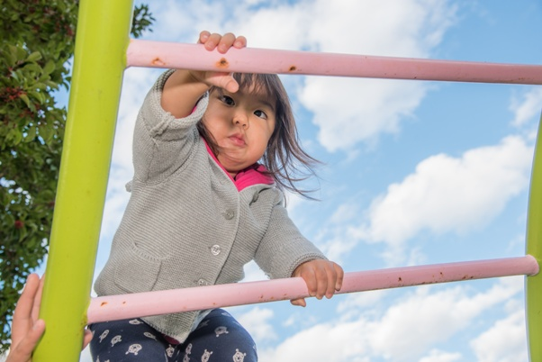 child climbing play structure