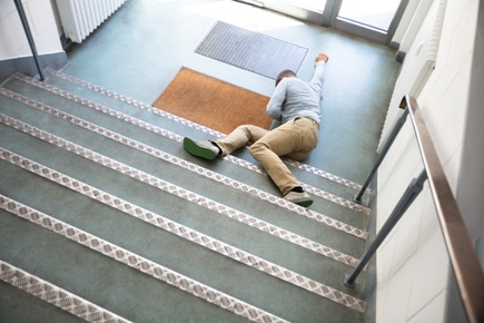 injured man at bottom of staircase after fall
