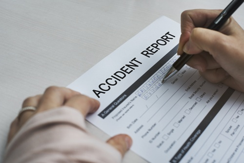 injured person filling out accident report form