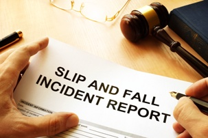 lawyer filling out slip and fall incident report form