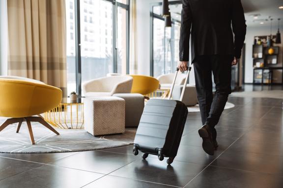 man walking through hotel lobby