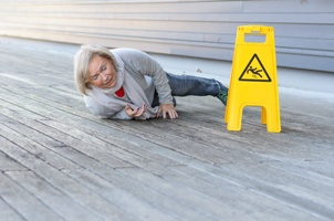 older woman falling on wet floor