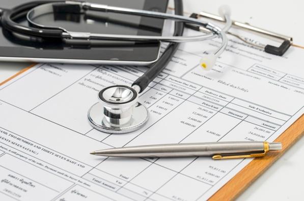 stethoscope on medical bills