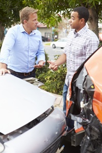 two men arguing over car accident damage