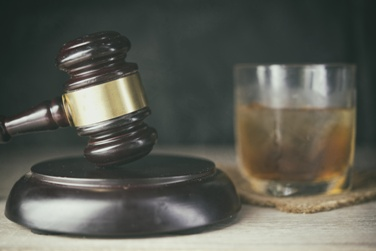Alcoholic Drink and a Wooden Gavel