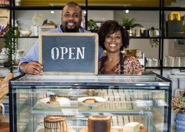 Business Owners Holding an Open Sign