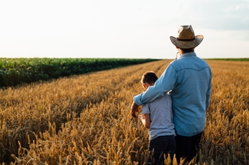Farmer With His Son on His Family Land
