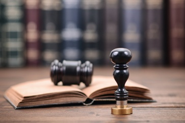 Law Book With Stamp and Gavel