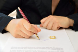 Woman Completing Divorce Paperwork