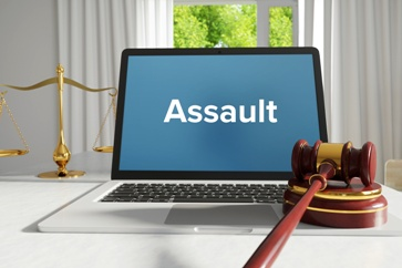 Assault on a Computer Screen With the Scales of Justice and a Gavel