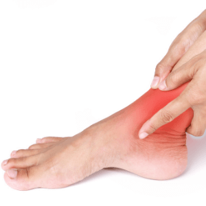 person holding their painful ankle