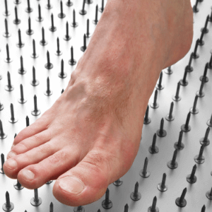 foot on a bed of nails