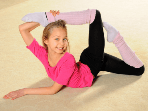 young girl in a gymnast pose